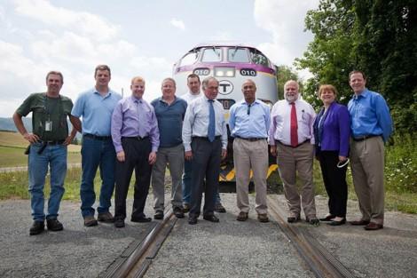 Gov. Deval Patrick, center, with Housatonic Railroad President John Hanlon to his left, toured the Berkshire line one year ago. Photo courtesy of MassDOT
