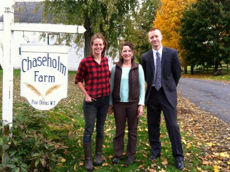 Sarah Chase, center, of Chaseholm Farm in Pine Plains, N.Y., with Benneth Phelps of the Carrot Project and Adam Higgins of Salisbury Bank.