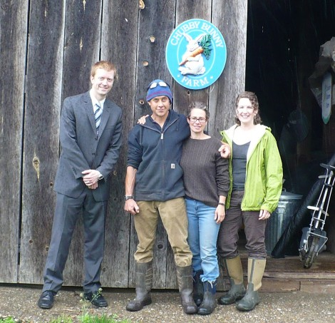 From left, Adam Higgins of Salisbury Bank, Dan and Tracy Hayhurst of Chubby Bunny Farm in Falls Village, Conn., and Benneth Phelps of the Carrot Project, at the Chubby Bunny Farm that received a Carrot Project loan.
