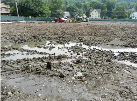 After torrential rains in July, standing water interrupted the bioremediation process, resulting in odors drifting from the site into the nearby neighborhood.
