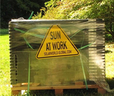 The solar panels, still i their packing, in the author's backyard.