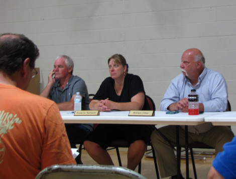 The Otis selectmen attend the August meeting during which voters overwhelmingly approved the first step in the wind turbine project. From left, Donald Hawley, Roberta Sarnacki and William Hiller. Photo: David Scribner